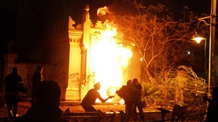 Fires raged in Cairo as protesters clashed with police outside Egypt's presidential palace in 2013.