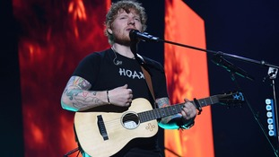 Sheeran is rarely seen on stage without his guitar.