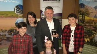 Gary McKee collects Freedom of the Borough award with his family