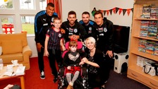 The players visited the hospice ahead of the game against Manchester United