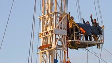 Campaigners scale metal rig in fracking protest