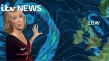 Emma Jesson in front of Atlantic weather graphic