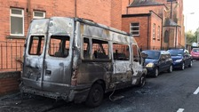 Several vehicles burnt in 'racially motivated hate crime'
