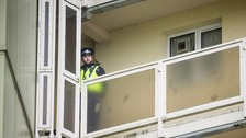 A policeman at the block of flats where the baby fell.