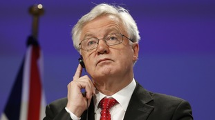Britain's Brexit Secretary David Davis attends a press conference with European Union EU chief negotiator Michel Barnier.
