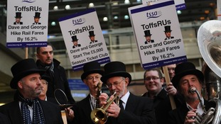 Rail campaigners from the transport union TSSA demonstrate outside St Pancras station