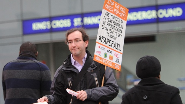 A rail campaigner demonstrates outside King's Cross station in London as regulated fares