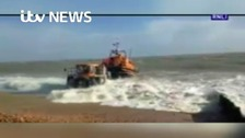 Lifeguards search stormy seas for missing surfers