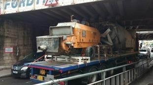 Lorry stuck under bridge causing delays