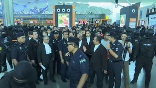A heavy police presence accompanied the trial parties.