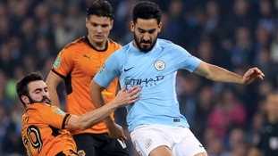 Wolverhampton Wanderers' Jack Price (left) and Manchester City's Ilkay Gundogan battle for the ball.