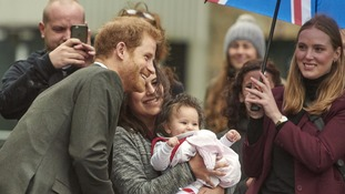 Prince Harry posed for a photo with Syrian refugee Noura Bittar Soeborg and her daughter.