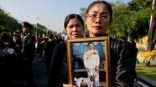 Black-clad mourners thronged the streets to pay their respects