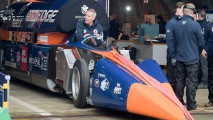 Pilot Andy Green climbs into the cockpit of the Bloodhound.
