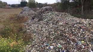 Mountain of rubbish dumped near canal