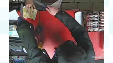 Police have released images of an armed robbery in Accrington