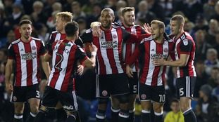 Sheffield United's Billy Sharp (second right) celebrates scoring his side's first goal of the game during the Sky Bet Championship match at Elland Road, Leeds.