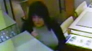 CCTV image of woman with dark brown hair