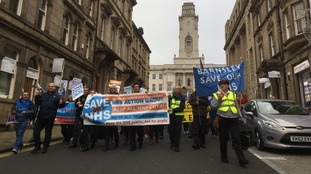 More than 100 people take to the streets in protest over NHS cuts