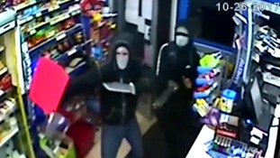 Shopkeeper fights off knife-wielding robbers with bottle and boxes