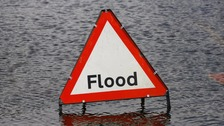 There are flood warnings in East Anglia with high tides and strong winds forecast.