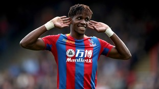 Wilfried Zaha rescued a late point for Crystal Palace after goals from Chicharito and Ayew had put West Ham in front.