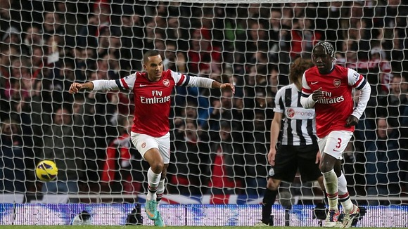 Theo Walcott scoring one of his three goals in Arsenal's 7-3 win against Newcastle