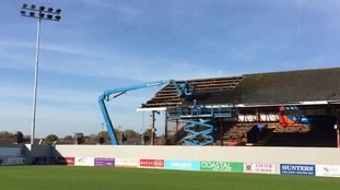 Demolition of Exeter City's historic grandstand gets underway