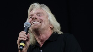 Sir Richard Branson introduces Paul Weller at the 2010 V Festival in Chelmsford.