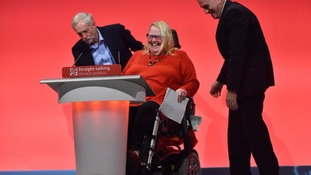 Labour leader Jeremy Corbyn and shadow Chancellor John McDonnell assist Councillor Candy Atherton off the stage after her wheelchair became stuck on the stage after her speech.