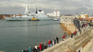Crowds watch HMS Dauntless begin her maiden deployment.