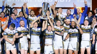 Leeds Rhinos players celebrate with the trophy after the final whistle during the Betfred Super League Grand Final