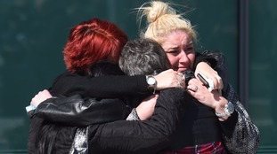 Relatives hug outside the Hillsborough inquests in 2016.