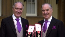 Sir David Barclay (left) and his twin brother Sir Frederick after receiving their knighthoods from the Queen at Buckingham Palace