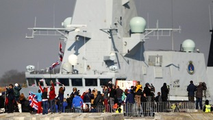 People wave from the Round Tower as the Royal Navy Type 45 Destroyer HMS Dauntless sets sail from Portsmouth.