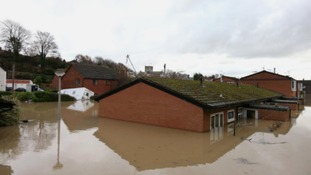 Flood waters come close to covering houses in St. Asaph, Denbighshire, North Wales