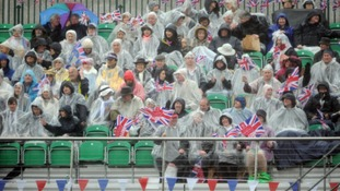 Royal revellers watch from the banks of the River Thames, during the Diamond Jubilee River Pageant.