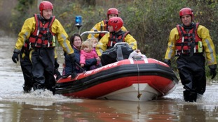 A women and her children are rescued from their house in Gloucester in November.
