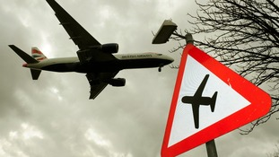 Sign seen near Heathrow, as an aircraft descends to land at the west London airport.