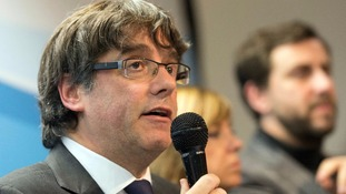 Spain seeks international arrest warrant for sacked Catalan leader as ex-ministers jailed