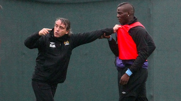 Members of the City coaching team dragged Balotelli away from his boss
