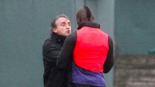 The striker had to be separated from Blues boss Roberto Mancini, who reacted after Balotelli caught Scott Sinclair with a late challenge