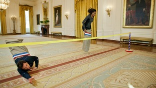 First Lady Michelle Obama wins a potato sack race with talk show host Jimmy Fallon at the White House (January 25)