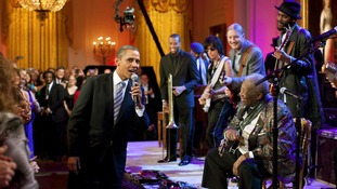Egged on by B.B. King (R) the President joins in singing 'Sweet Home Chicago' during a concert at the White House (February 21)