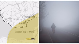 Map and cyclist in fog