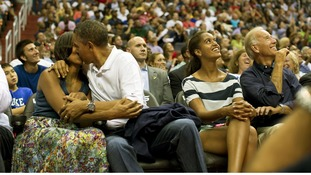 The President and First Lady appeared on the 'Kiss Cam' during a game between the US Men's Olympic basketball team and Brazil (July 16)