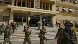 Russian military police soldiers walk outside a hospital in Deir al-Zour.