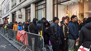 Customers queue outside the Regent Street Apple store.