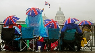 Spectators watch the River Pageant as part of the Queen&#x27;s Diamond Jubilee celebrations