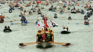 The 'Gloriana' leads the hand-powered craft past Chelsea Bridge during the Diamond Jubilee river pageant